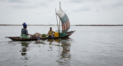 Woman and child in dugout canoe, Ganvie Village, Benin. [NO MODEL RELEASE]