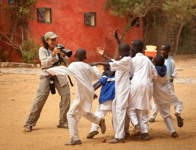 Exuberant children posing for photos, Goree Island, Senegal. [NO MODEL RELEASE]